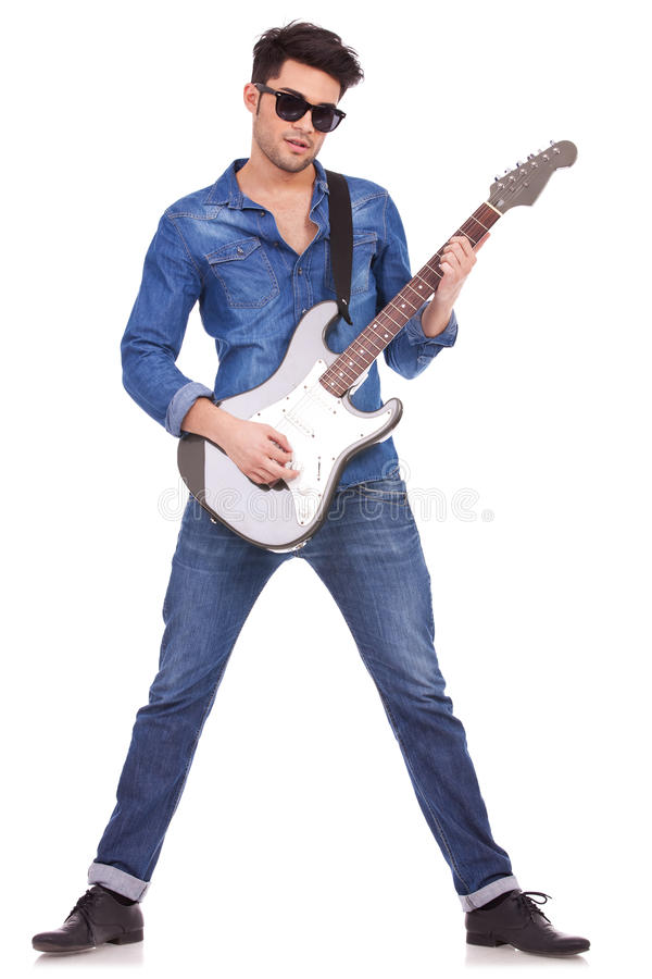 Download Young man playing guitar stock photo. Image of background - 26964318