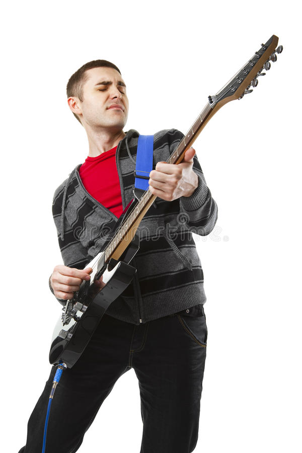 Young man playing guitar over white background royalty free stock image