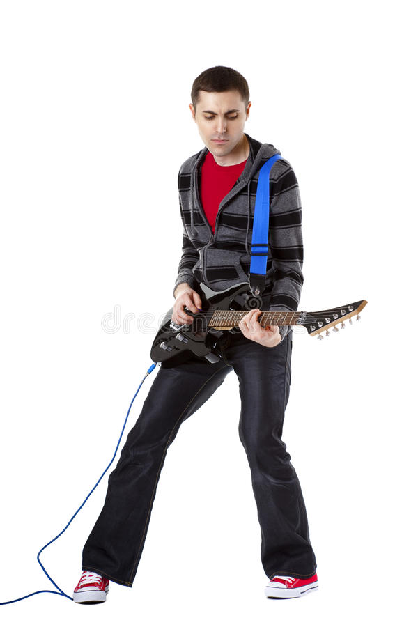 Young man playing guitar over white background stock photo