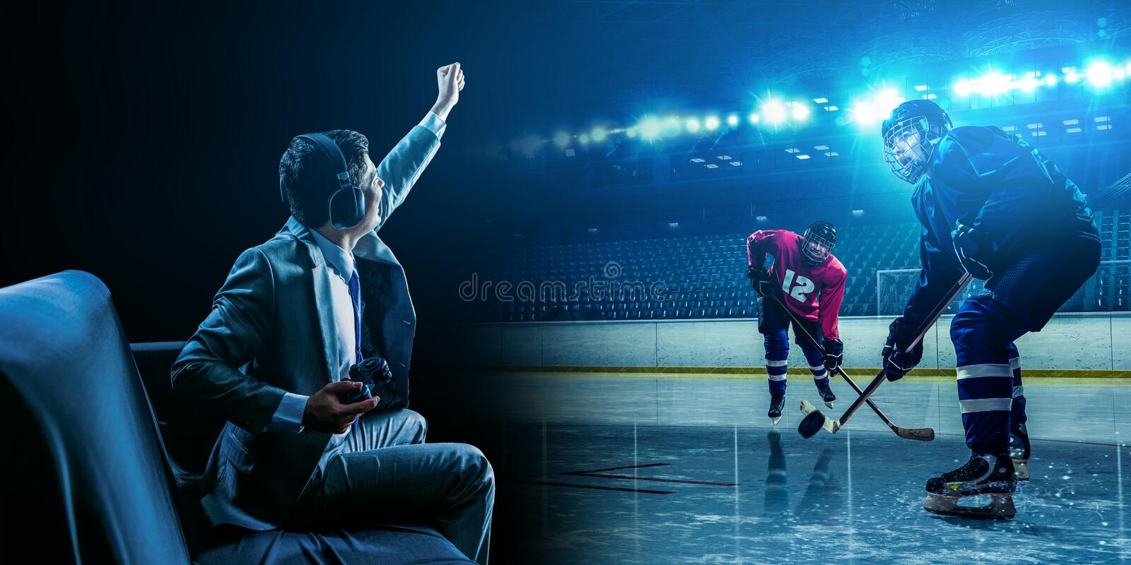 Young man playing ice hockey game stock photography