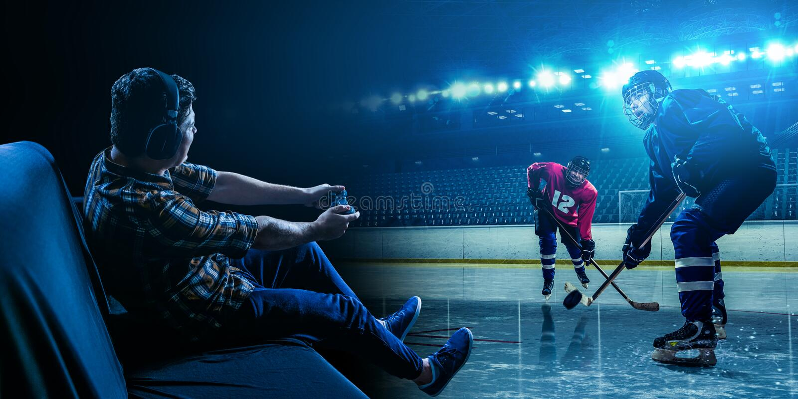 Young man playing ice hockey game stock photos