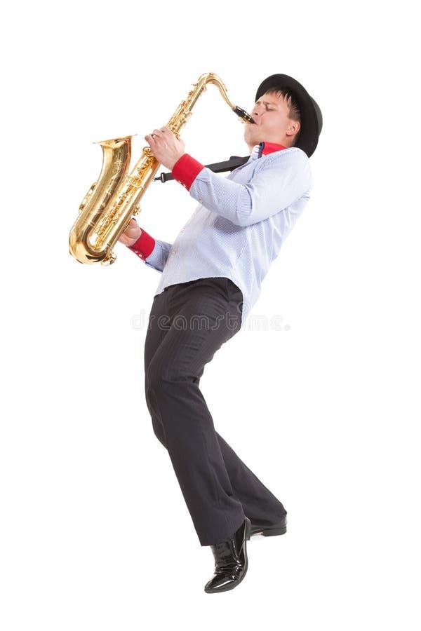 Young man playing on saxophone stock photos