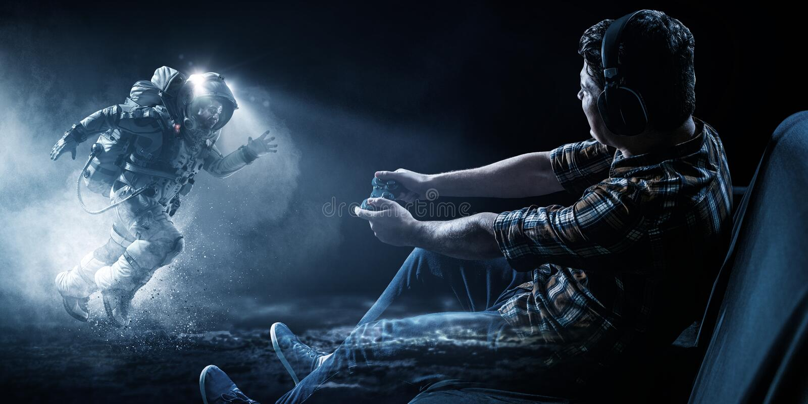 Young man playing space adventure video game royalty free stock photo