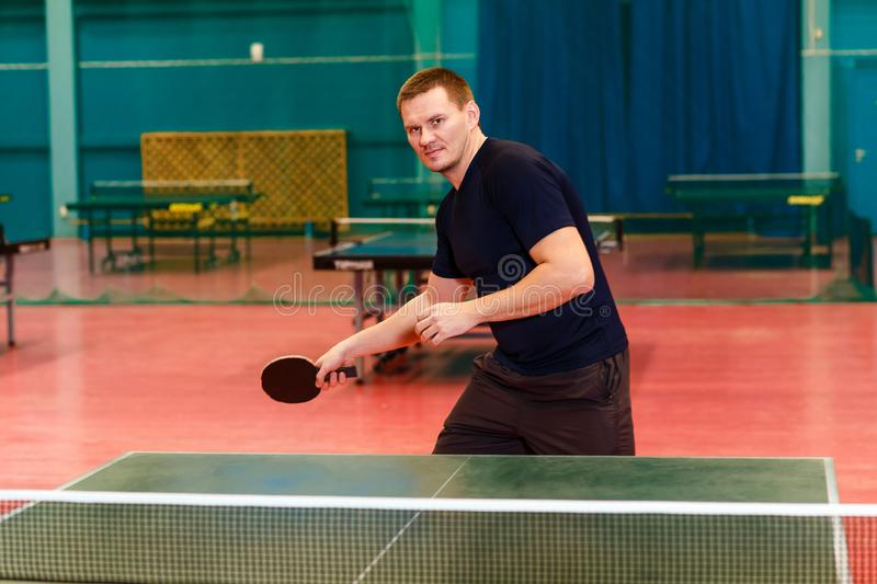 Young man playing table tennis royalty free stock photography