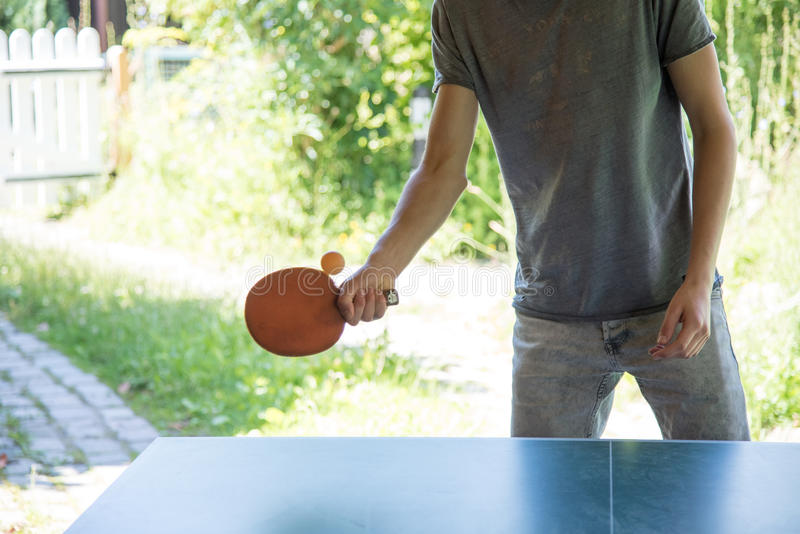 Young man playing table tennis outside royalty free stock images