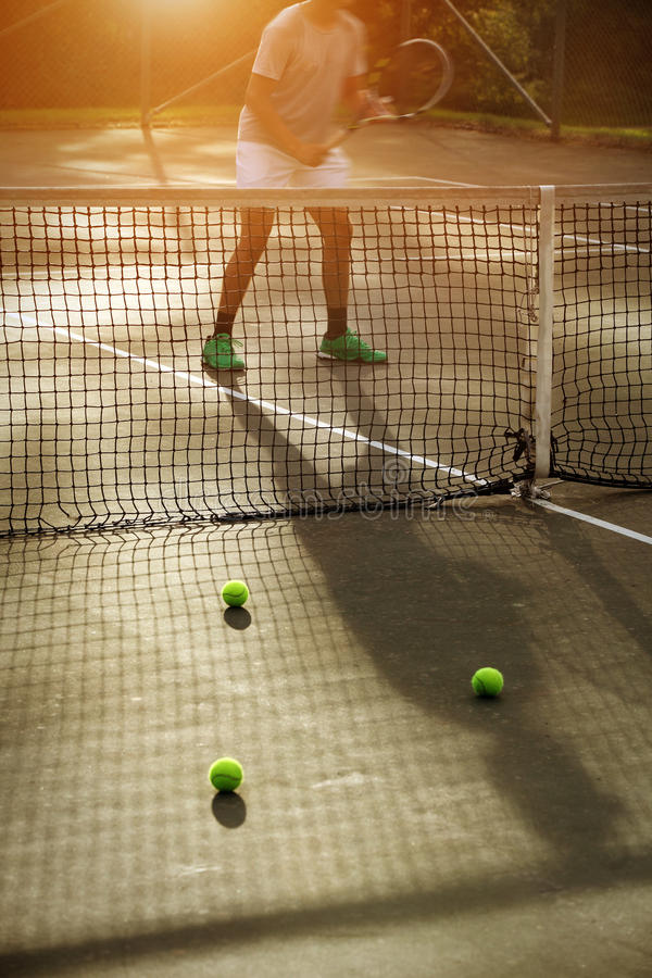 Young man playing tennis outdoor stock photography