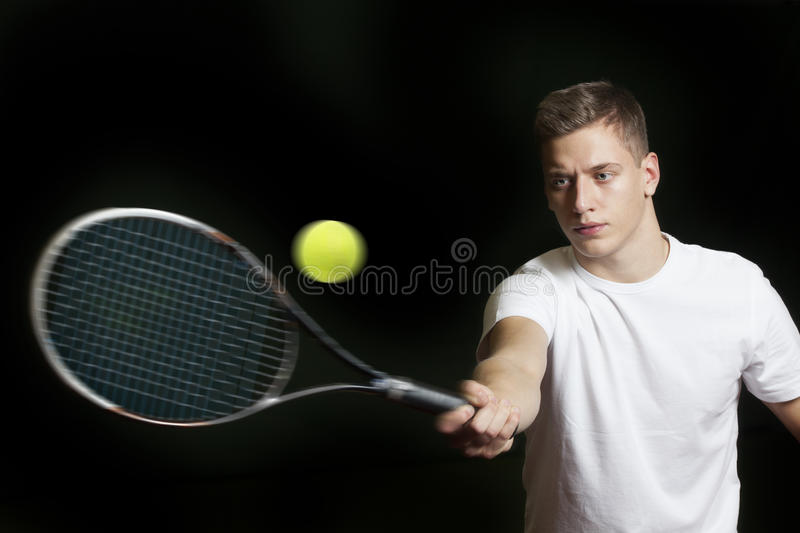 Young man playing tennis stock photography