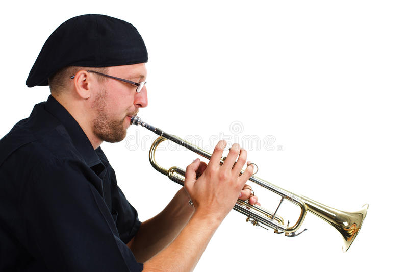 Young man playing the trumpet. Portrait of a young man wearing black shirt and cap, playing the trumpet - isolated on white stock photos