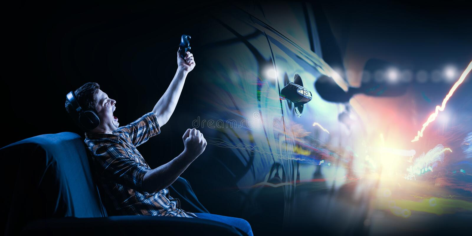 Young man playing video game royalty free stock photography