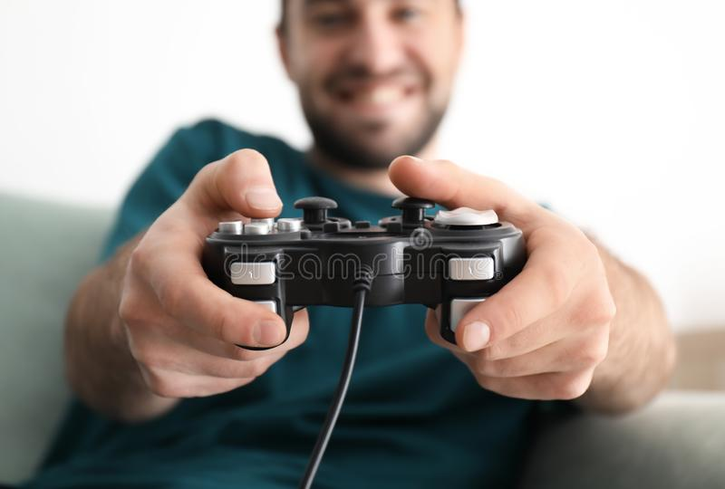 Young man playing video games at home royalty free stock image