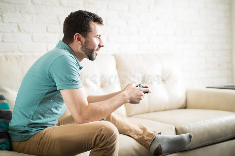 Young man playing videogames royalty free stock photos