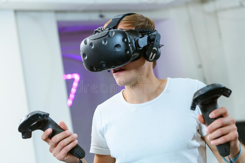 Young man is playing VR games royalty free stock photography