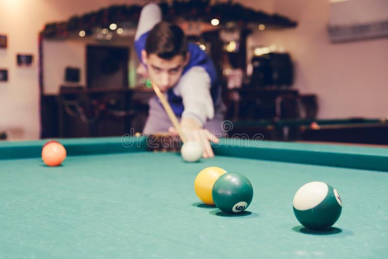 Young man plays billiards. hobbies stock image
