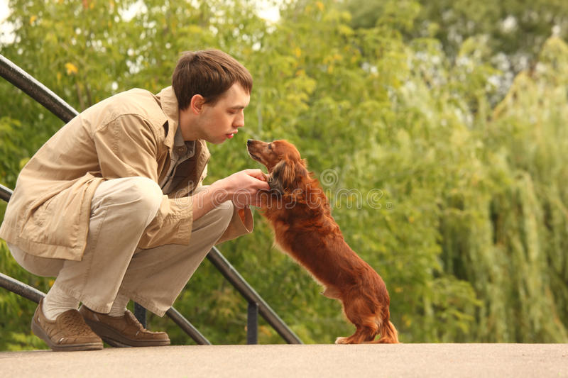 Download Young Man Plays With His Adorable Dachshund Stock Photo - Image: 11411226