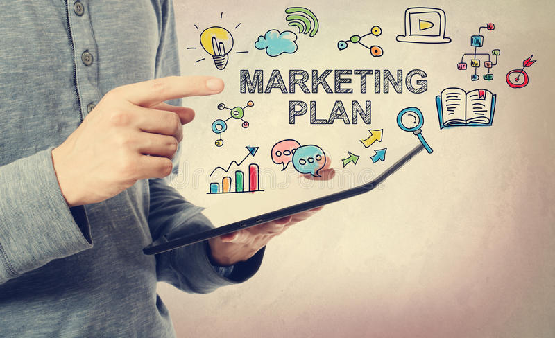Young man pointing at Marketing Plan concept stock images