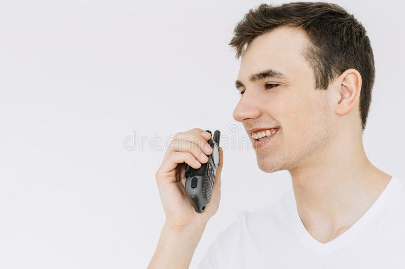 Young Man with portable radio Isolated on the White Background. Close-up stock photo