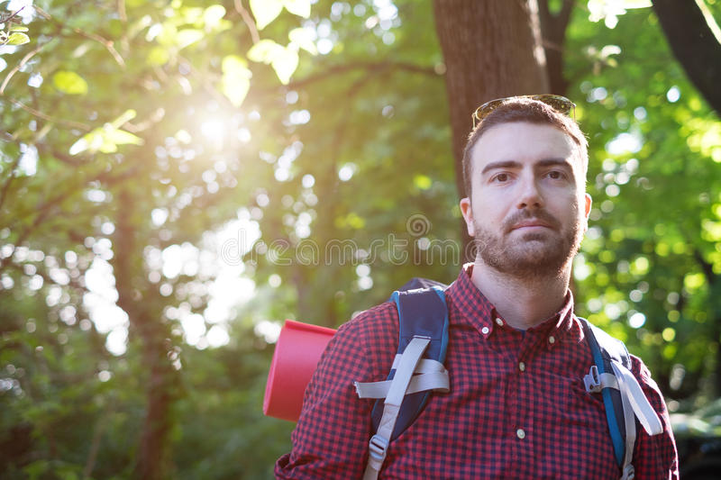 Young man portrait hiking in the forest royalty free stock photo