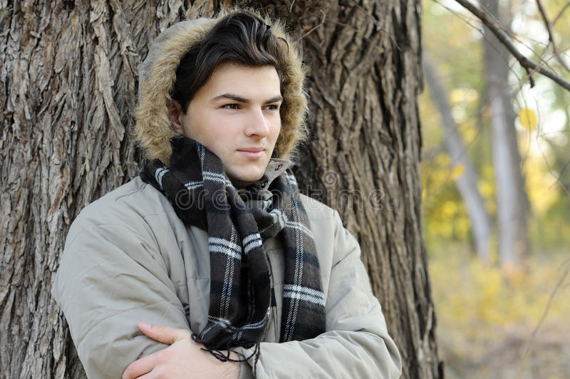 Young man portrait in park. stock image