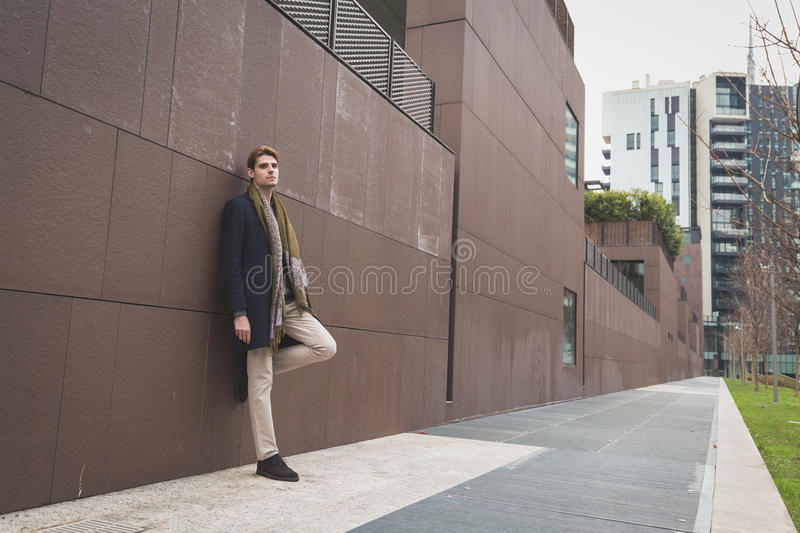 Young man posing in the city streets stock images
