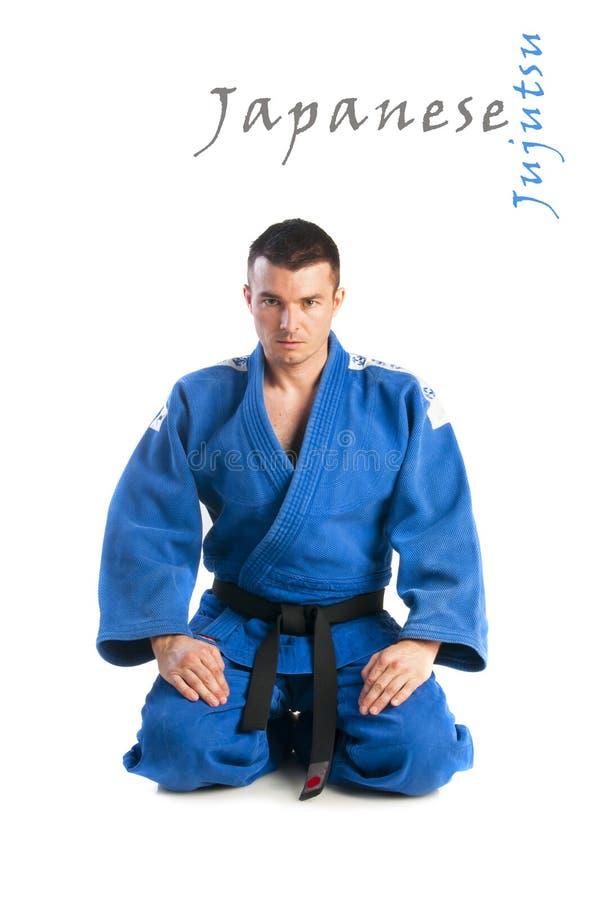 Young man practicing jiu-jitsu (Hakki Heysen Ryu school). Young handsome man practicing jiu-jitsu (Hakki Heysen Ryu school) isolated on white background stock photos