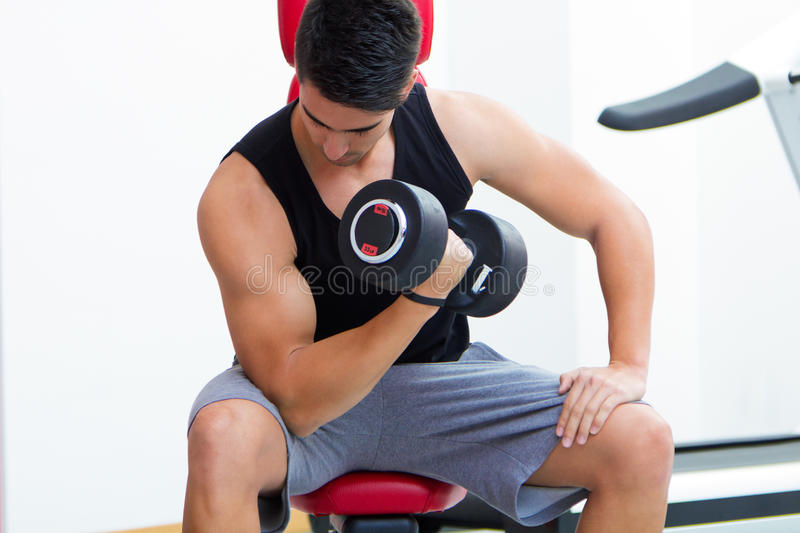 Young man practicing sport in gym stock image