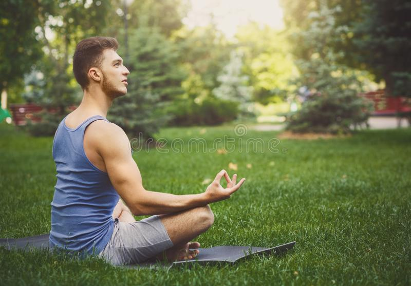 Young man practicing yoga, relax meditation pose royalty free stock photos