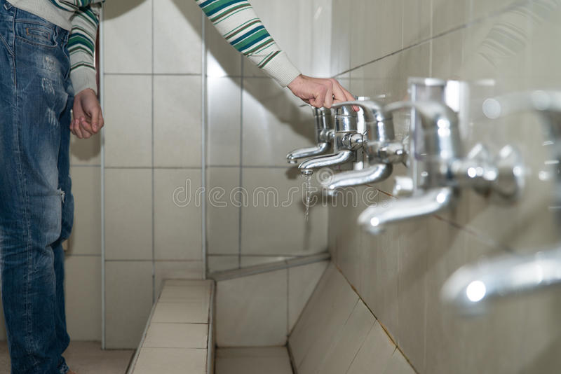 Young Man Prepairing To Take Ablution. Muslim Man Preparing To Take Ablution In Mosque stock photo