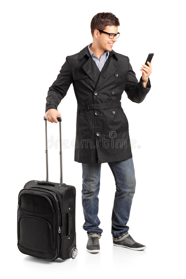 Download Young Man Prepared For A Yourney Typing A Sms Stock Photo - Image: 23470244