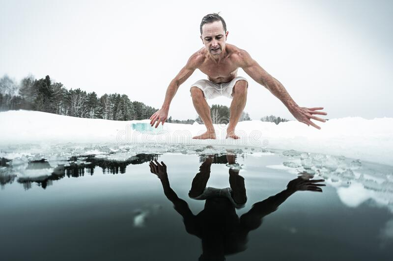 Young man prepares to swim in the ice hole royalty free stock photos