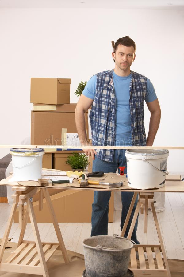 Young man preparing to paint new home stock photos