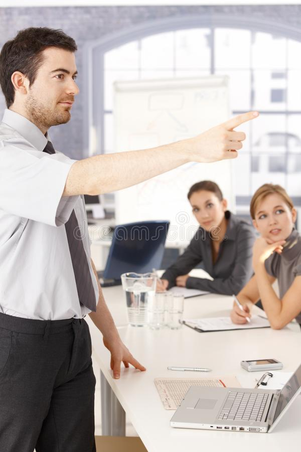 Young man presenting in meeting room stock image