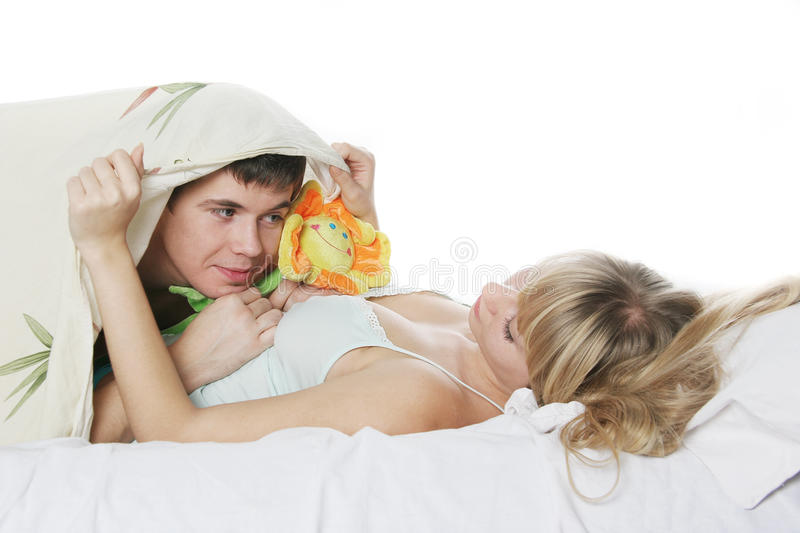 Download Young Man Presenting Toy Flower To Girl In Bed Stock Photo - Image: 17534294