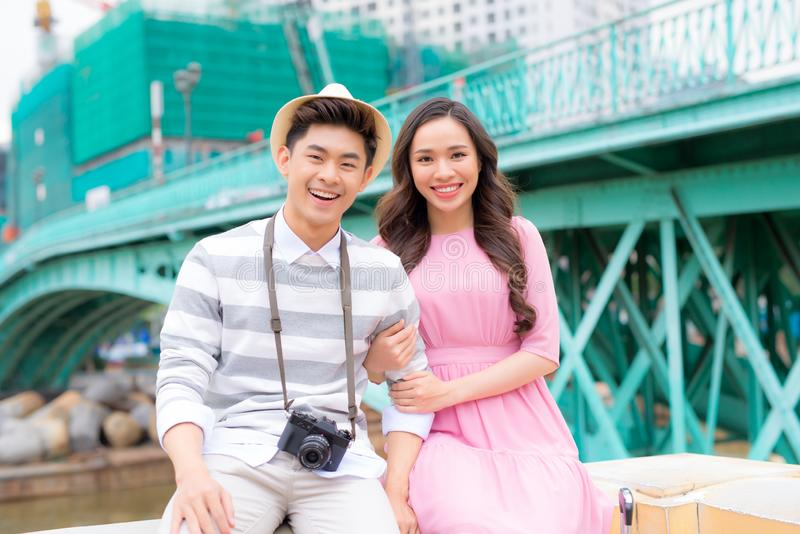 Young man and pretty girl are having fun in the city at evening. Young men and pretty girl are having fun in the city at evening stock images