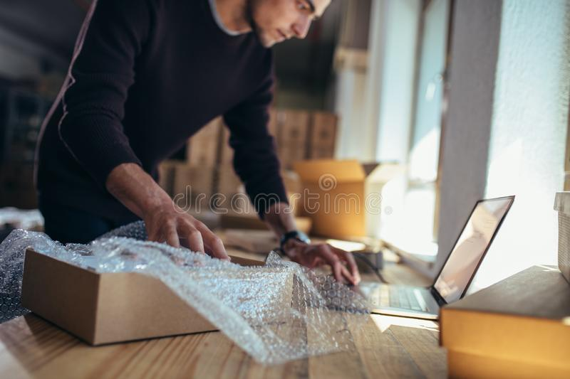 Verifying the product details before delivery stock photo