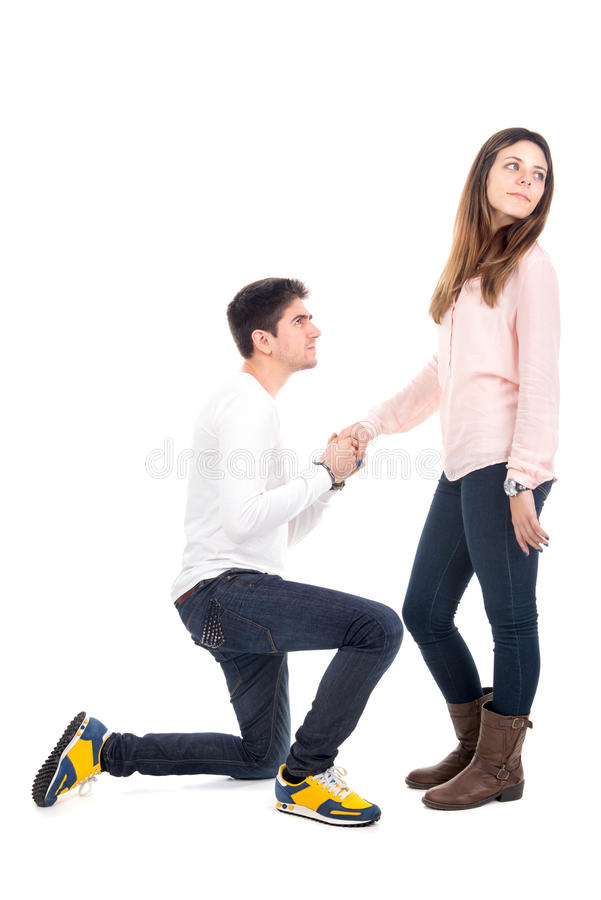 Young man proposing. Young men proposing to his girlfriend royalty free stock images
