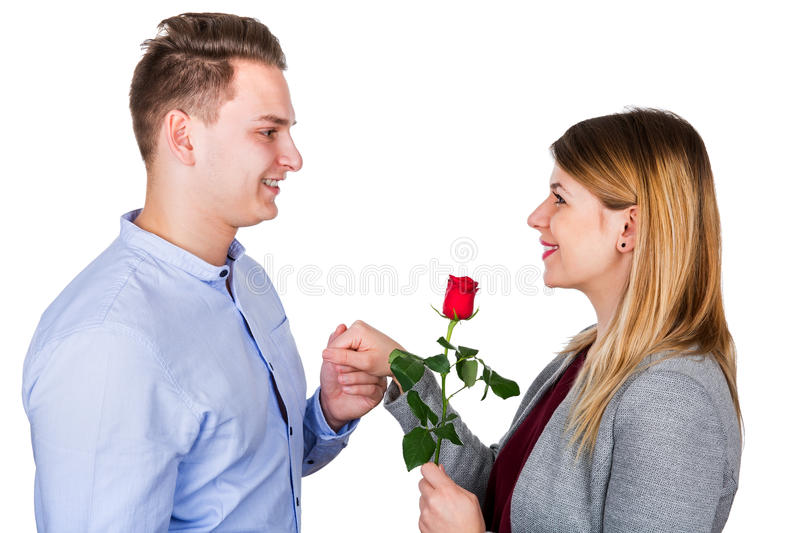 Young man proposing. Picture of a young men proposing to his girlfriend - isolated background stock photography