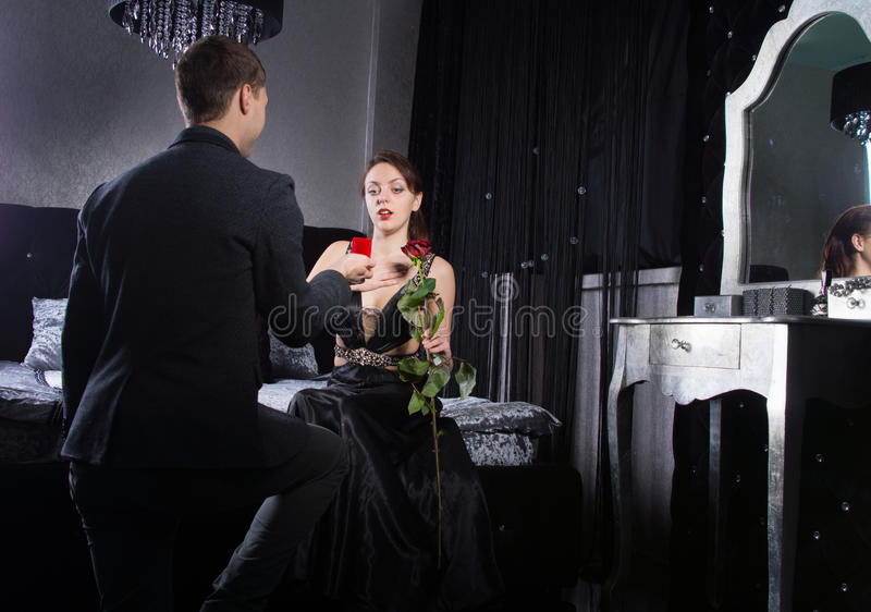 Young Man Proposing to Girlfriend at the Bedroom. Close up Young Man Proposing to his Girlfriend While at the Bedroom stock images