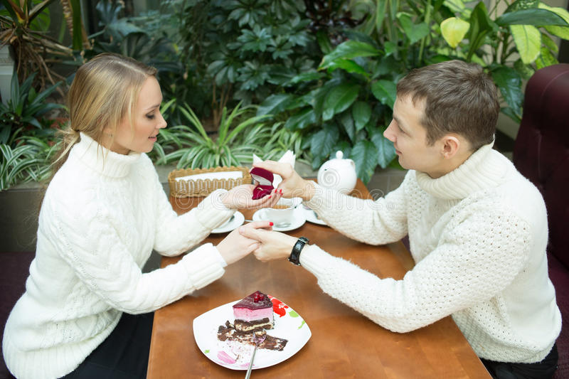 Young man proposing to girlfriend offering. Young men proposing to girlfriend offering engagement ring stock image