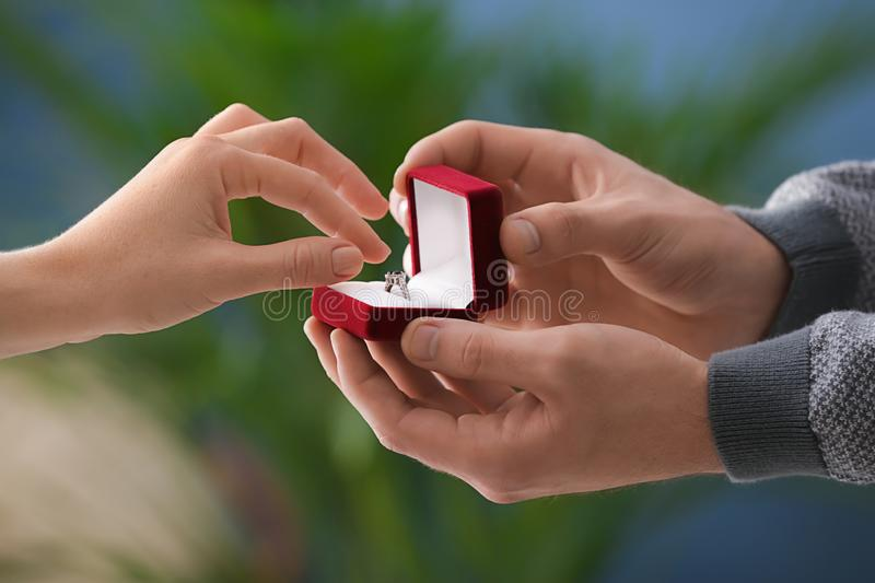 Young man proposing to his beloved at romantic date royalty free stock photos