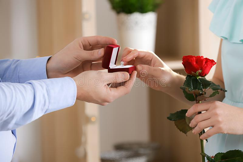 Young man proposing to his beloved at romantic date royalty free stock images