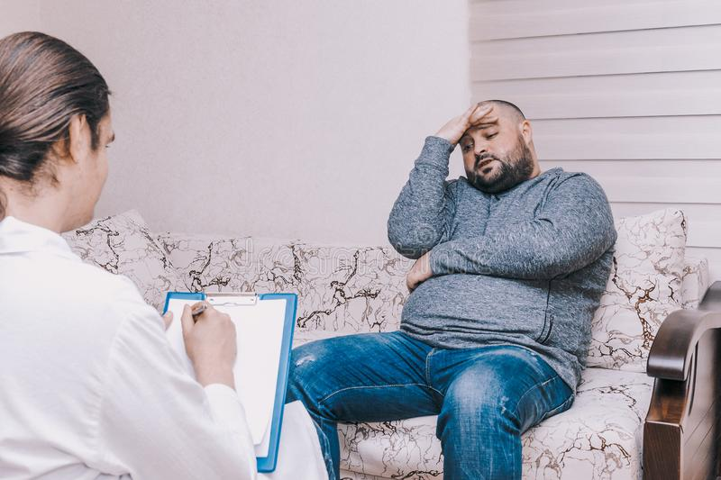 Young man at the psychotherapist visit, talking about his problems with emotions, mental health concept stock images