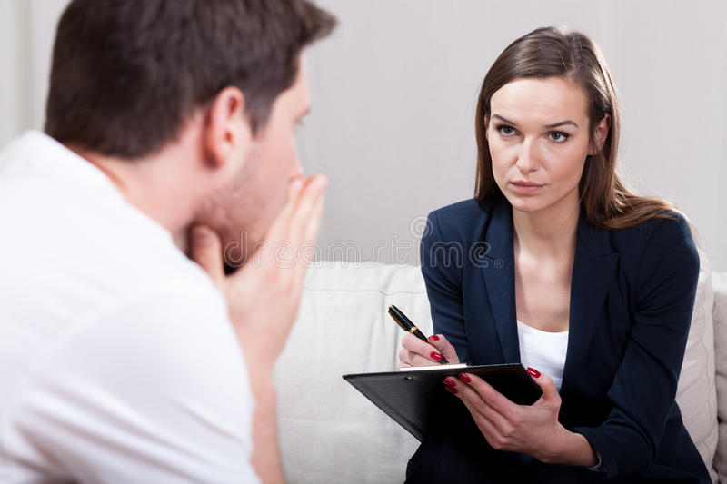 Young man during psychotherapy stock photography