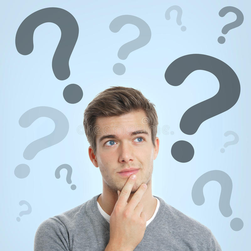 Young man with question marks stock photo