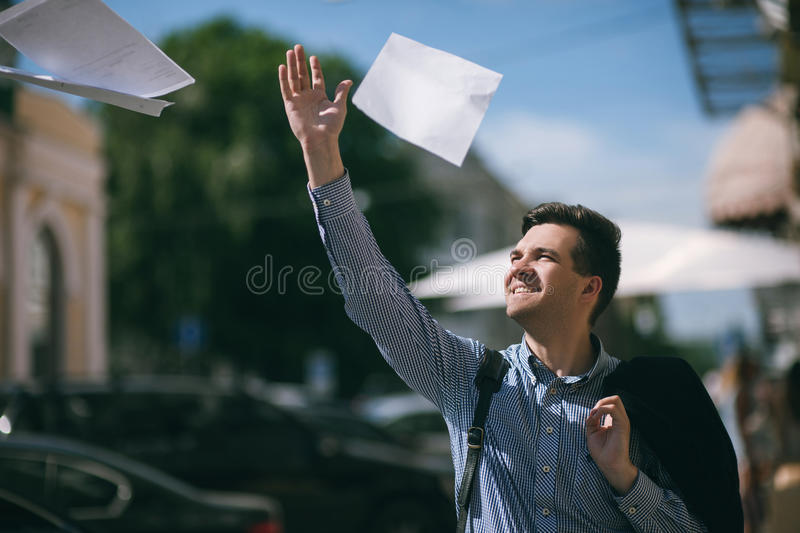 Young man quit job. Happy businessman. Freedom and success for male royalty free stock images