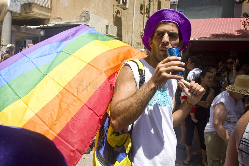 Download Young Man With Rainbow Flag At Pride Parade TA Editorial Photography - Image: 20096632