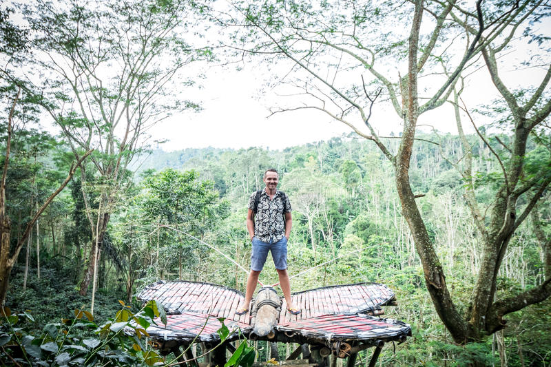 Young man in rainforest of tropical Bali island, Indonesia. royalty free stock image