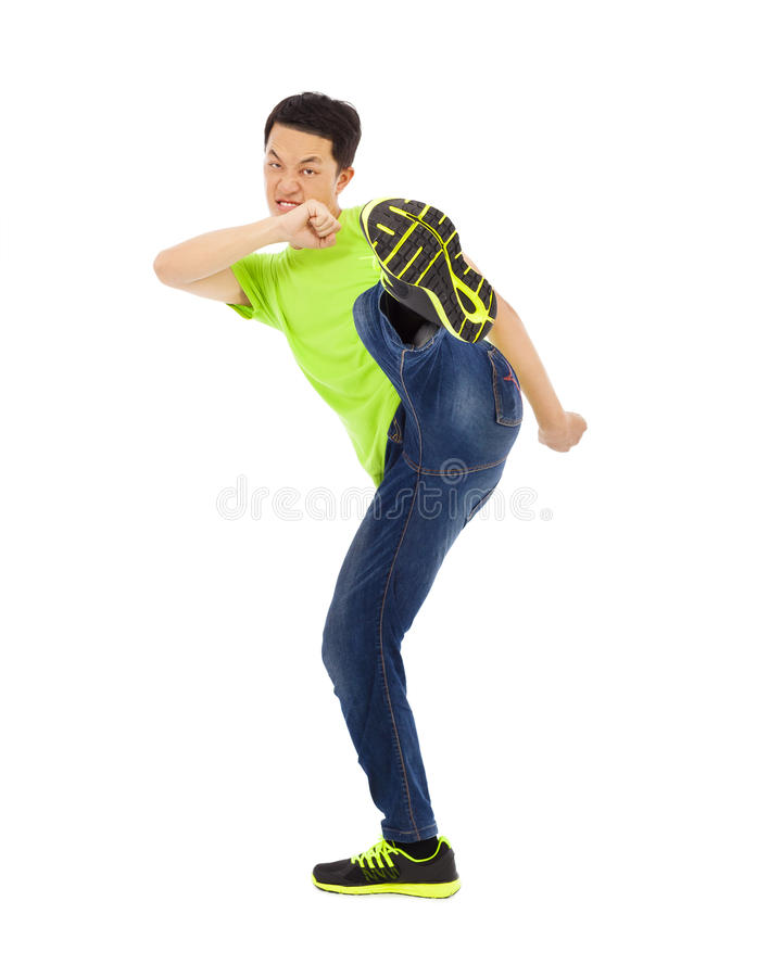 Free Young Man Raise Leg To Kick. Kong Fu Concept Royalty Free Stock Image - 42842066