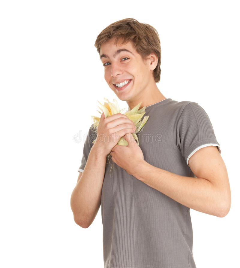 Young man with raw corn, maize