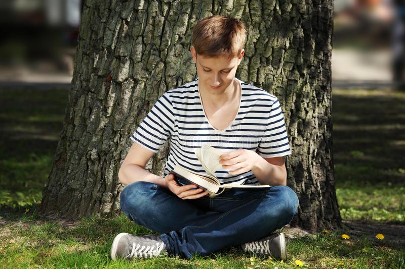 Download Young man reading book stock photo. Image of sitting - 19679930