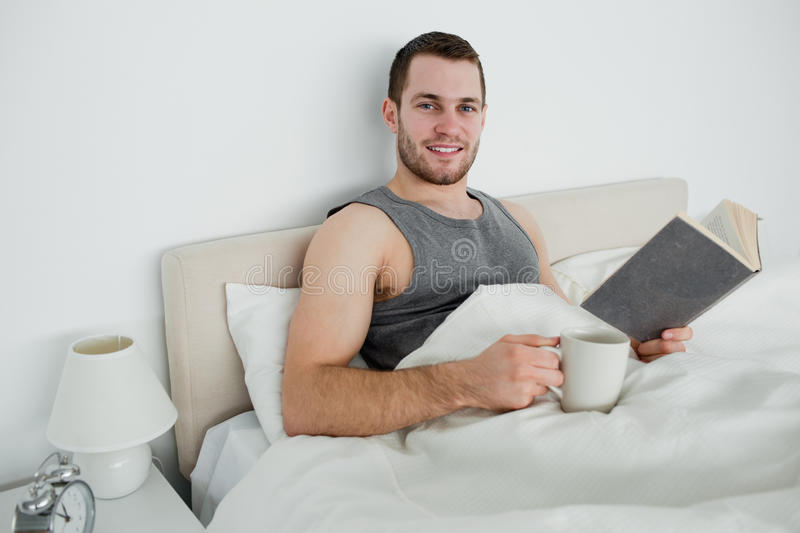 Download Young Man Reading A Novel While Drinking A Coffee Stock Photos - Image: 22143643